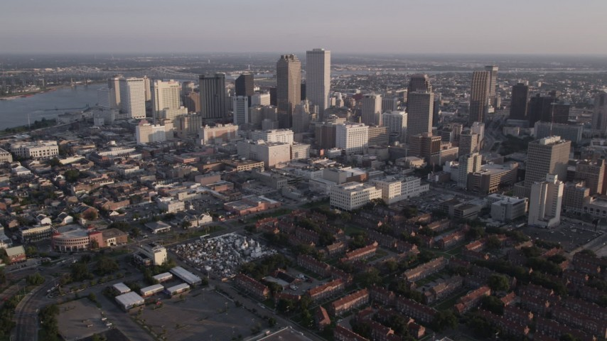 5K aerial video of Downtown New Orleans at sunset, seen from French Quarter and Iberville, Louisiana Aerial Stock Footage | AX61_016