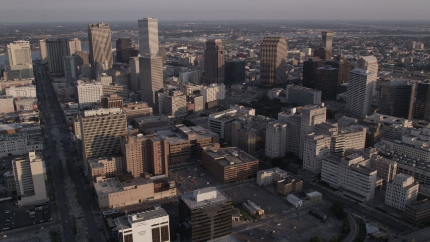 5K aerial video of skyscrapers and city buildings at sunset in Downtown New Orleans, Louisiana Aerial Stock Footage | AX61_017