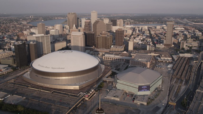5K aerial video orbit Superdome, New Orleans Arena in Downtown New Orleans at sunset, Louisiana Aerial Stock Footage | AX61_018