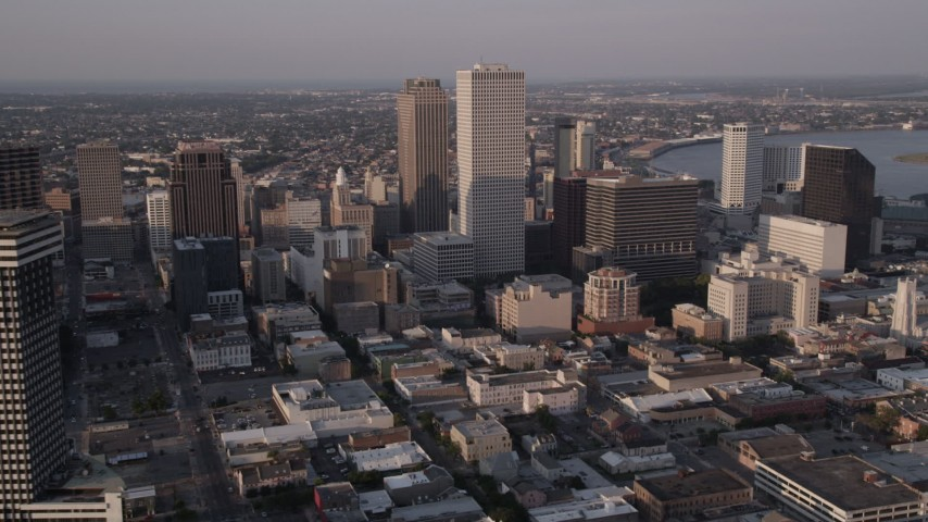 5K stock footage aerial video of Plaza Tower and Downtown New Orleans skyscrapers at sunset, Louisiana Aerial Stock Footage | AX61_019