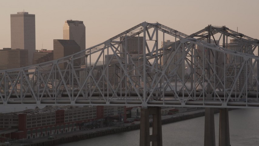 5K aerial video of light traffic on Crescent City Connection Bridge at sunset, New Orleans, Louisiana Aerial Stock Footage | AX61_024