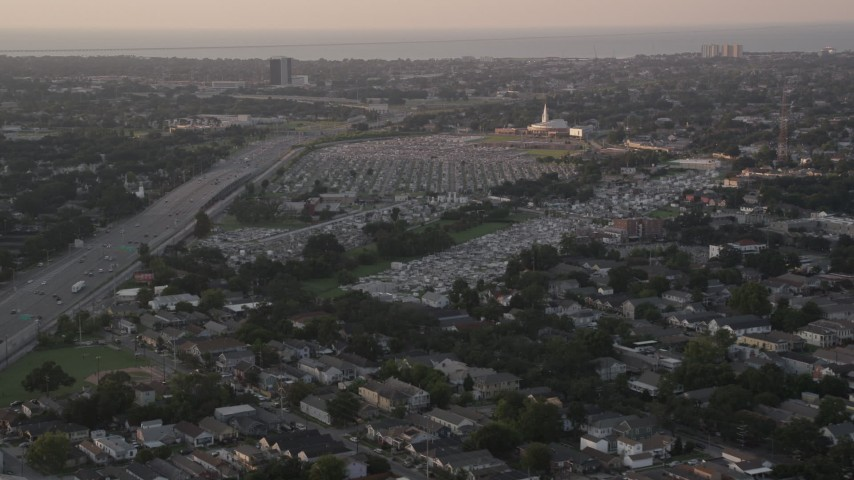 5K aerial video of Greenwood Cemetery and First Baptist New Orleans church at sunset, Lakeview, Louisiana Aerial Stock Footage AX61_030