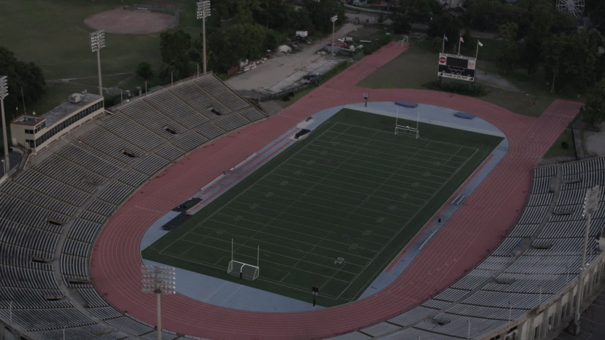 5K stock footage aerial video approach Tad Gormley Stadium in City Park at sunset, New Orleans, Louisiana Aerial Stock Footage | AX61_033