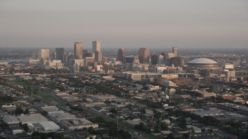 5K aerial video approach skyscrapers in Downtown New Orleans at sunset, Louisiana Aerial Stock Footage | AX61_035