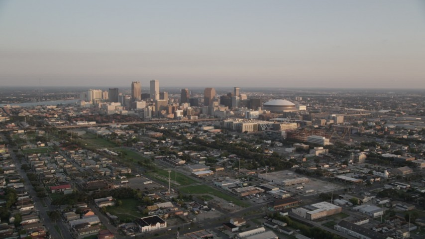 5K aerial video approach high-rises and skyscrapers in Downtown New Orleans at sunset, Louisiana Aerial Stock Footage AX61_036