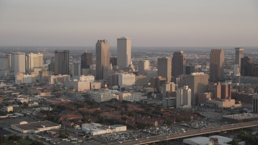 5K stock footage aerial video of Downtown New Orleans skyscrapers and Iberville Projects at sunset, Louisiana Aerial Stock Footage | AX61_037