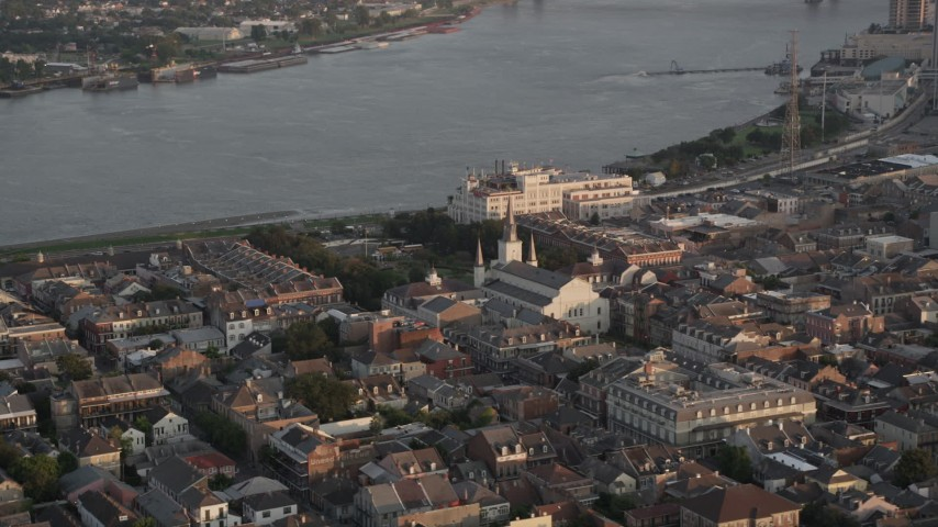 5K aerial video of St. Louis Cathedral and Jackson Square at sunset, French Quarter, New Orleans, Louisiana Aerial Stock Footage | AX61_038