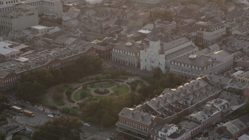 5K stock footage aerial video orbit St. Louis Cathedral and Jackson Square at sunset in the French Quarter, New Orleans, Louisiana Aerial Stock Footage | AX61_040