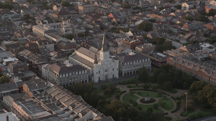 5K aerial video orbit St. Louis Cathedral by Jackson Square in the French Quarter at sunset, New Orleans, Louisiana Aerial Stock Footage | AX61_041