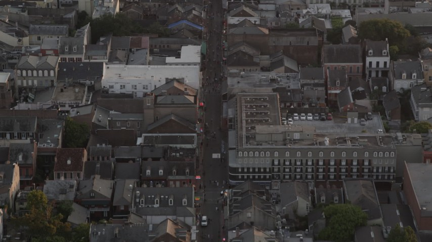 5K aerial video follow famous Bourbon Street through French Quarter, New Orleans at sunset, Louisiana Aerial Stock Footage | AX61_043