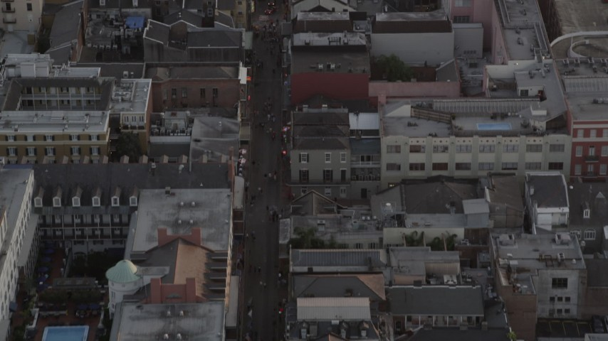 5K stock footage aerial video of famous Bourbon Street in the French Quarter of New Orleans at sunset, Louisiana Aerial Stock Footage | AX61_044