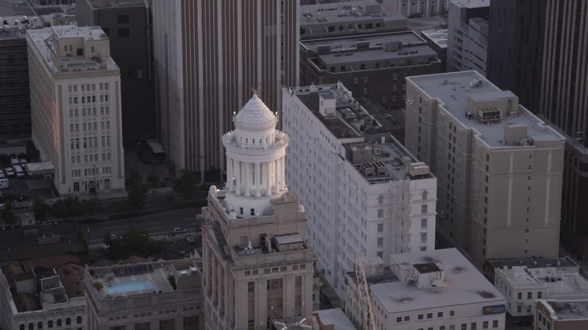 5K aerial video approach the tower atop the Hibernia Bank building at sunset, Downtown New Orleans, Louisiana Aerial Stock Footage | AX61_045