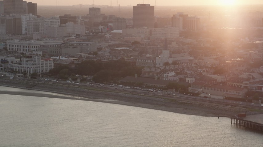 5K stock footage aerial video of St. Louis Cathedral in the French Quarter of New Orleans, Louisiana at sunset, seen from the river Aerial Stock Footage | AX61_052
