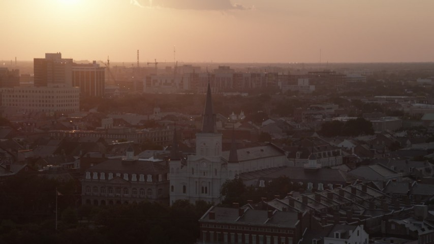 5K stock footage aerial video approach the French Quarter's St. Louis Cathedral from the river at sunset, New Orleans, Louisiana Aerial Stock Footage | AX61_053