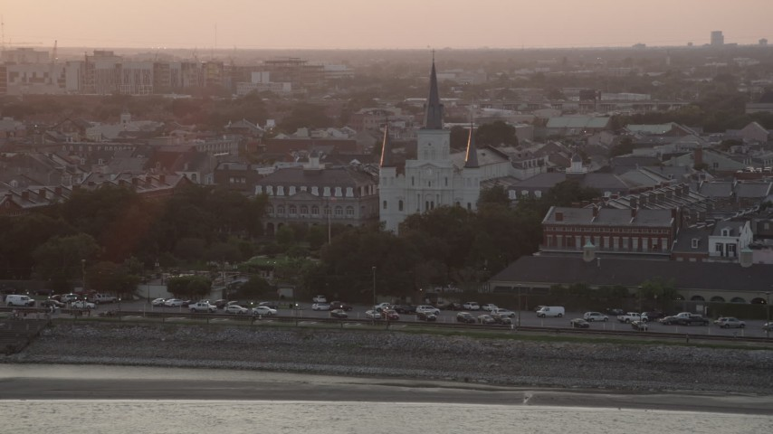 5K aerial video of a reverse view of St. Louis Cathedral at sunset, French Quarter, New Orleans, Louisiana Aerial Stock Footage | AX61_054