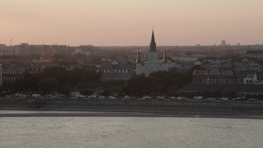 5K stock footage aerial video of St. Louis Cathedral at sunset in the French Quarter of New Orleans, Louisiana Aerial Stock Footage | AX61_055