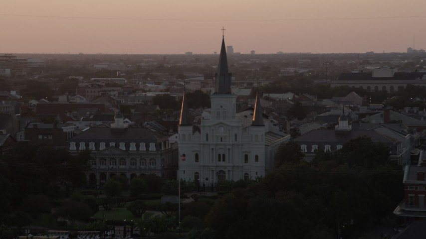 5K stock footage aerial video ascend and approach St. Louis Cathedral at sunset, French Quarter, New Orleans, Louisiana Aerial Stock Footage | AX61_057