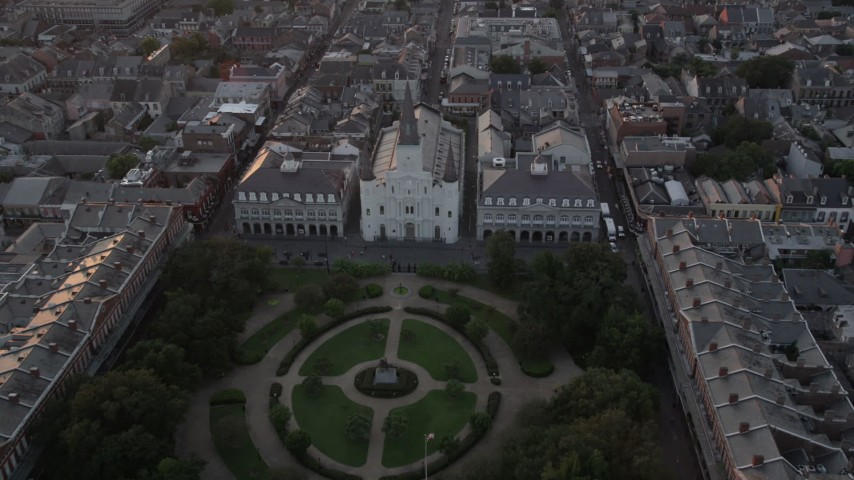 5K aerial video fly over Jackson Square to approach St. Louis Cathedral at sunset, French Quarter, New Orleans, Louisiana Aerial Stock Footage | AX61_058