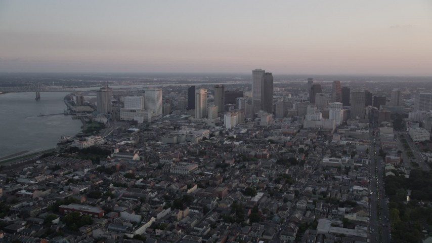 5K stock footage aerial video of the French Quarter and skyscrapers in Downtown New Orleans at sunset, Louisiana Aerial Stock Footage | AX61_061