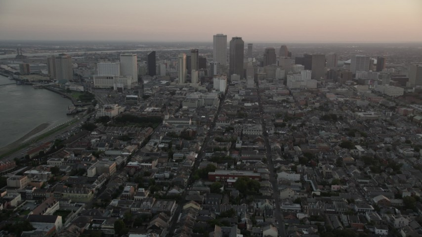 5K aerial video of a view across the French Quarter at Downtown New Orleans at sunset, Louisiana Aerial Stock Footage AX61_062