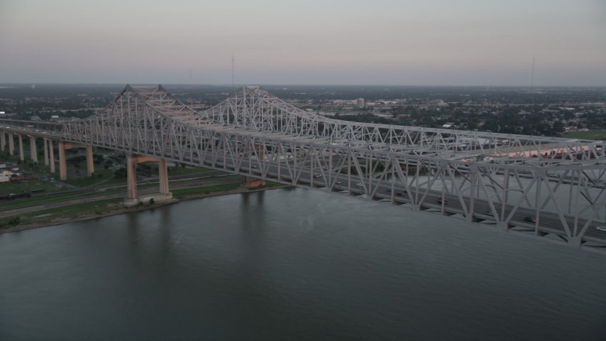 5K aerial video of light traffic on the Crescent City Connection Bridge at sunset, New Orleans, Louisiana Aerial Stock Footage | AX61_065