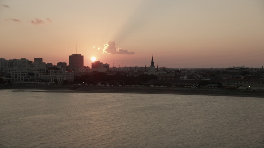 5K stock footage aerial video of setting sun behind St. Louis Cathedral in the French Quarter, New Orleans, Louisiana Aerial Stock Footage | AX61_067