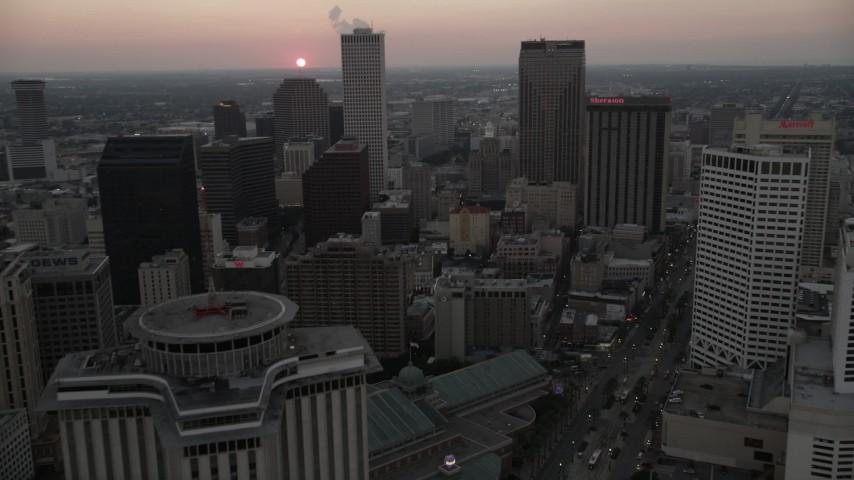 5K aerial video fly west over Downtown New Orleans at sunset, Louisiana Aerial Stock Footage | AX61_074