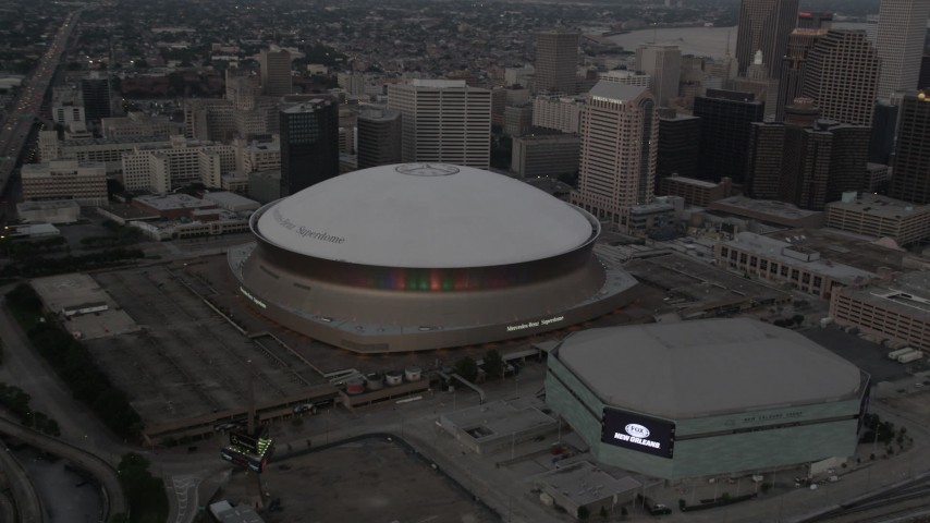 5K stock footage aerial video orbit the Superdome and New Orleans Arena at sunset, Downtown New Orleans, Louisiana Aerial Stock Footage | AX61_076