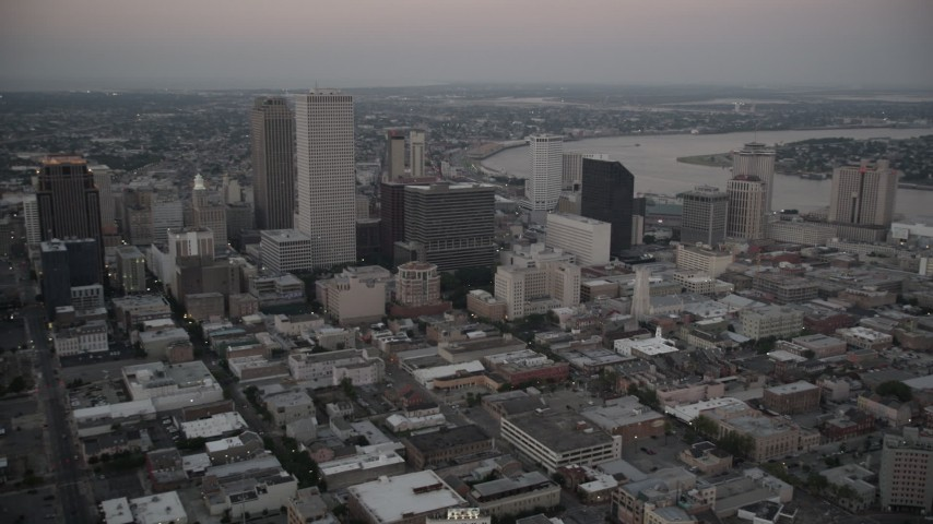 5K stock footage aerial video flyby Plaza Tower and skyscrapers in Downtown New Orleans at sunset, Louisiana Aerial Stock Footage | AX61_077