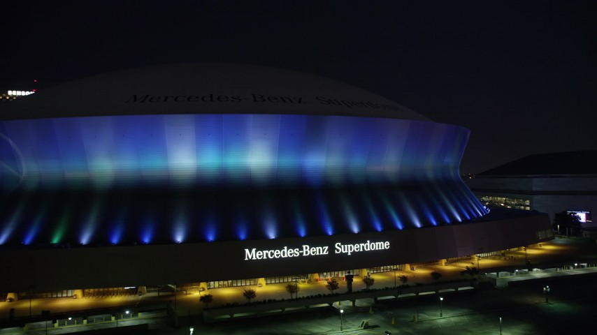 5K stock footage aerial video of ascending from the Mercedes-Benz Superdome at night, New Orleans, Louisiana Aerial Stock Footage | AX62_001