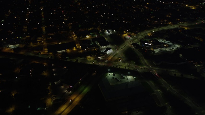 5K stock footage aerial video of slow moving traffic on Mid-City New Orleans city streets at night, Louisiana Aerial Stock Footage | AX62_004