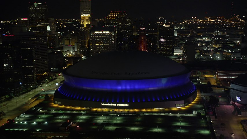 5K stock footage aerial video approach Superdome and skyscrapers at night, Downtown New Orleans, Louisiana Aerial Stock Footage | AX62_005