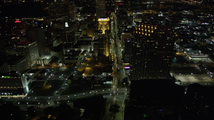 5K aerial video follow Poydras Street through Downtown New Orleans at night, Louisiana Aerial Stock Footage | AX62_013