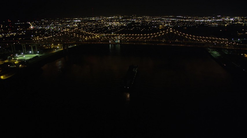5K aerial  video of cargo ship sailing under Crescent City Connection Bridge at night, New Orleans, Louisiana Aerial Stock Footage | AX62_015