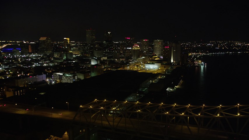 5K stock footage aerial video of Crescent City Connection Bridge and Downtown New Orleans, Louisiana at night Aerial Stock Footage | AX62_017