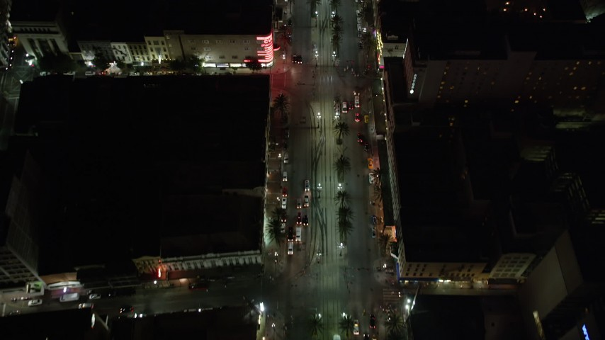 5K stock footage aerial video of bird's eye view of Canal Street through Downtown New Orleans at night, Louisiana Aerial Stock Footage | AX62_019