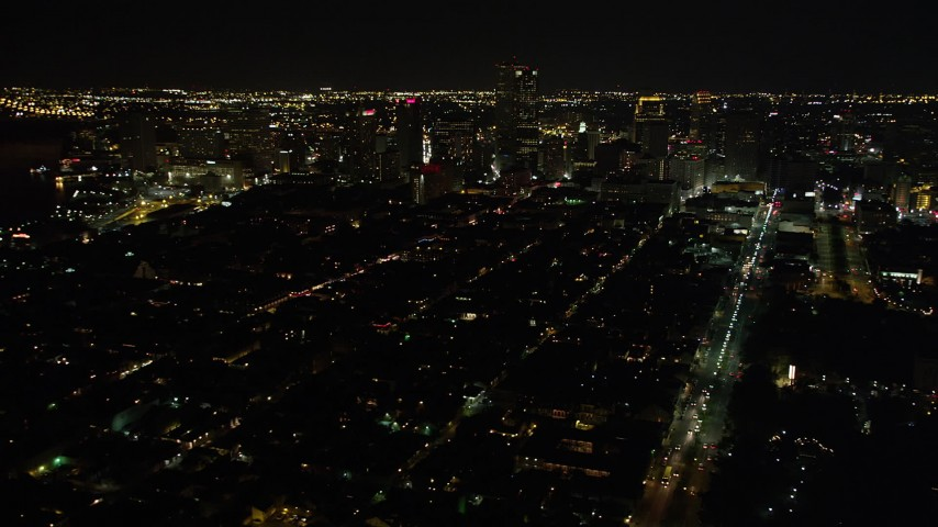5K aerial video of a view of Downtown New Orleans at night, Louisiana Aerial Stock Footage | AX62_021