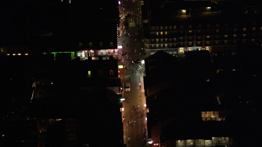 5K aerial video of bird's eye view of a crowd on Bourbon Street in the French Quarter at night, New Orleans, Louisiana Aerial Stock Footage | AX62_022