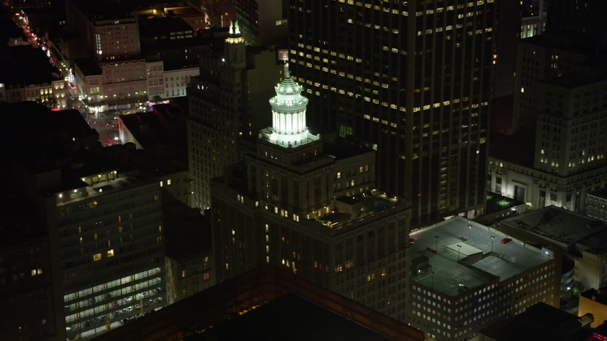 5K stock footage aerial video of the top of the Hibernia Bank Building at night, Downtown New Orleans, Louisiana Aerial Stock Footage | AX62_025