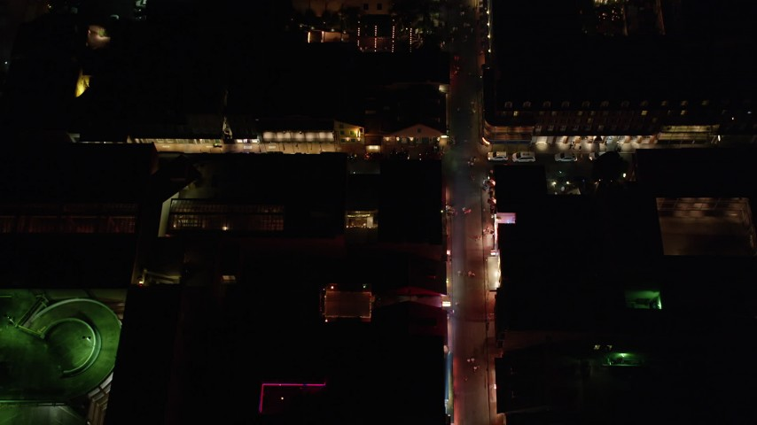 5K stock footage aerial video of a view of Bourbon Street through French Quarter at night, New Orleans, Louisiana Aerial Stock Footage | AX62_027