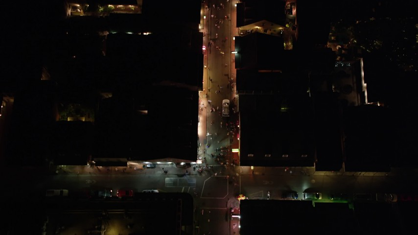 5K aerial video bird's eye of small crowd and tourists on Bourbon Street in the French Quarter at night, New Orleans, Louisiana Aerial Stock Footage | AX62_028