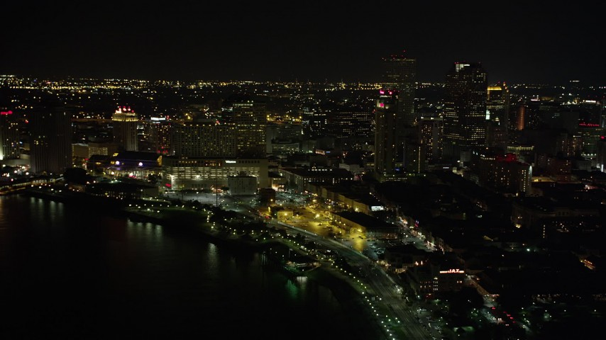 5K aerial video tilt from Jax Brewery to reveal Downtown New Orleans at night, Louisiana Aerial Stock Footage | AX62_029