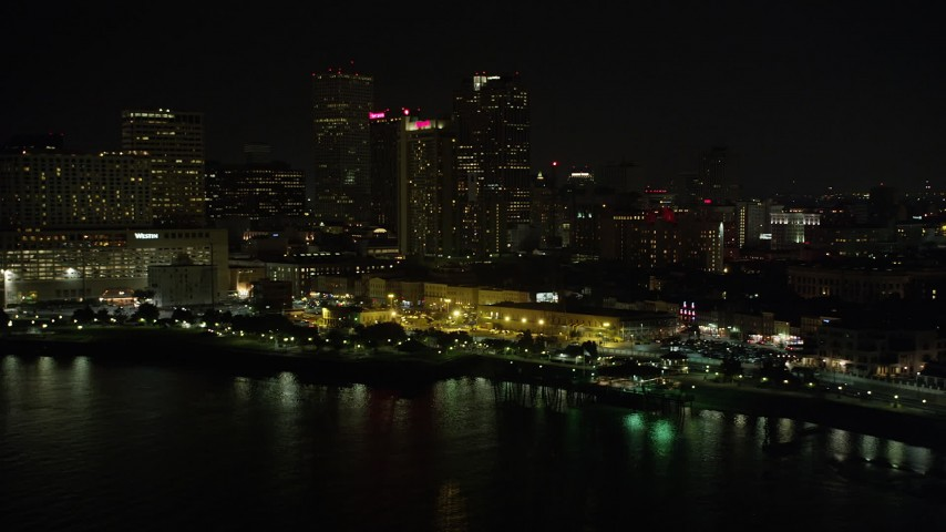 5K stock footage aerial video of Downtown New Orleans skyscrapers seen from the Mississippi River at night, Louisiana Aerial Stock Footage | AX62_030