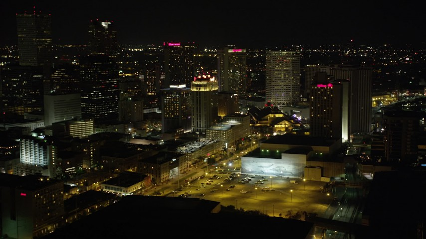 5K stock footage aerial video of hotels around Harrah's in Downtown New Orleans at night, Louisiana Aerial Stock Footage AX62_033