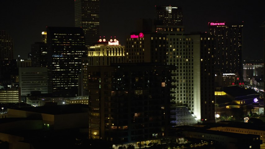 5K aerial video flyby Harrah's and Hilton Riverside in Downtown New Orleans at night, Louisiana Aerial Stock Footage | AX62_034