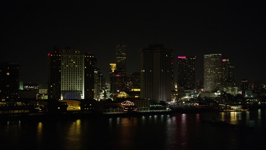 5K aerial video fly low by Hilton Riverside Hotel and World Trade Center in Downtown New Orleans at night, Louisiana Aerial Stock Footage | AX62_037