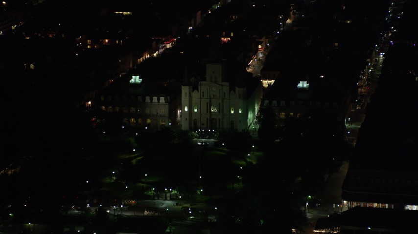 5K stock footage aerial video flyby Jax Brewery to reveal St. Louis Cathedral and Jackson Square at night, French Quarter, New Orleans, Louisiana Aerial Stock Footage | AX62_039