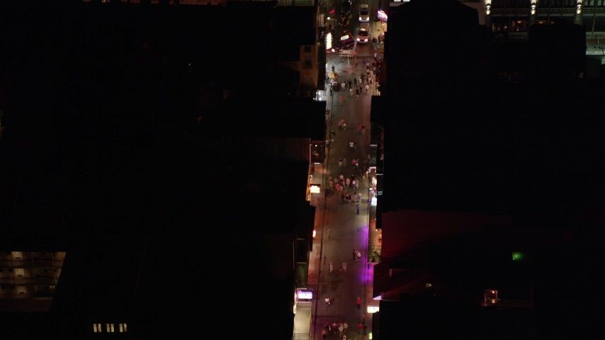 5K stock footage aerial video of bird's eye of tourists on Bourbon Street in the French Quarter at night, New Orleans, Louisiana Aerial Stock Footage | AX62_043