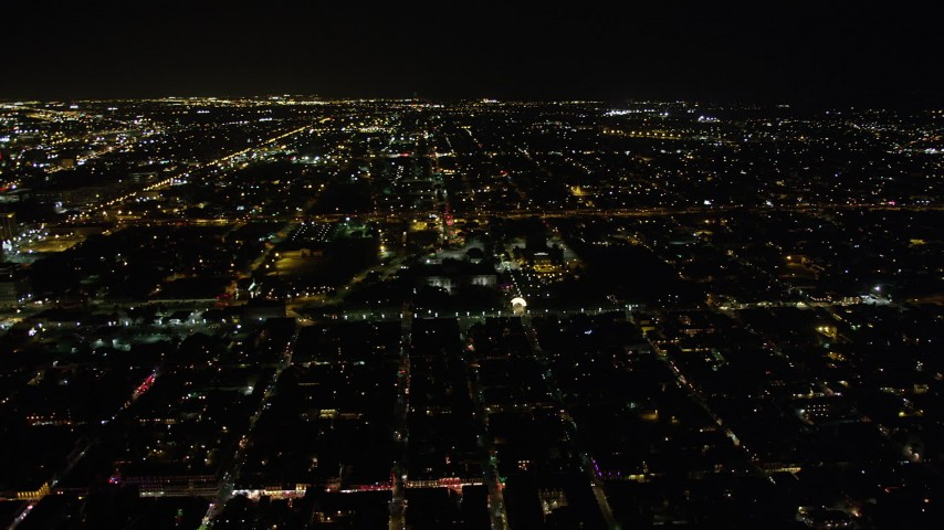5K stock footage aerial video of flying by the famous French Quarter at night, New Orleans, Louisiana Aerial Stock Footage | AX62_045
