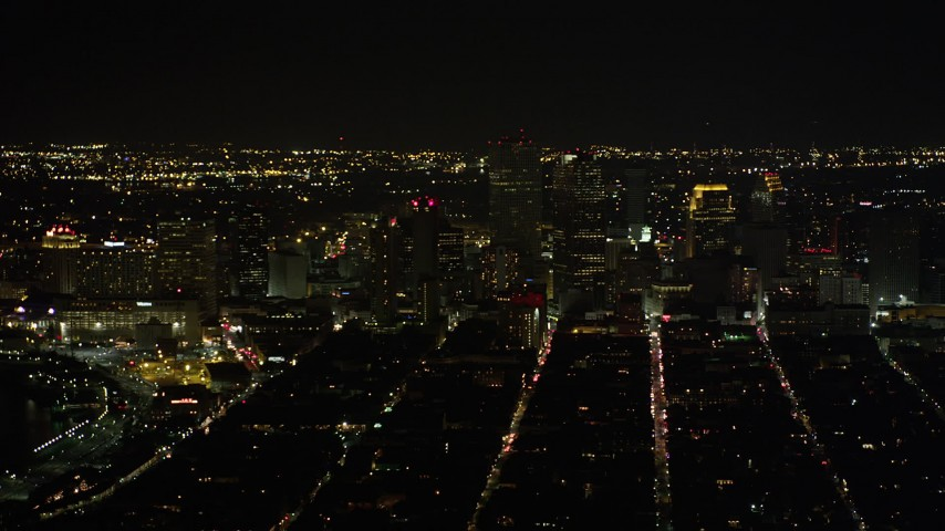 5K stock footage aerial video of Downtown New Orleans at night, seen from the French Quarter, Louisiana Aerial Stock Footage | AX63_004